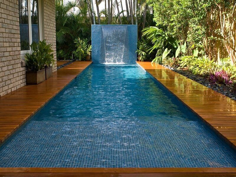 This is a long plunge pool with a waterfall feature at the far end. This pool is perfect for after a long sauna session, or an extended workout. You can just float in the cool water.