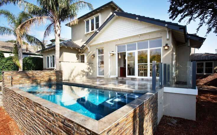 This small plunge pool is a perfect use of space. It is enough space to relax, and raised so you can have a good view of your neighborhood. A perfect pool for a couple.