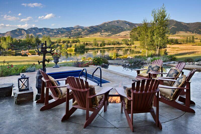 This is an amazing plunge pool on the far end of a fire pit, surrounded by chairs. This pool is great when the fire gets too hot and you need to cool off.
