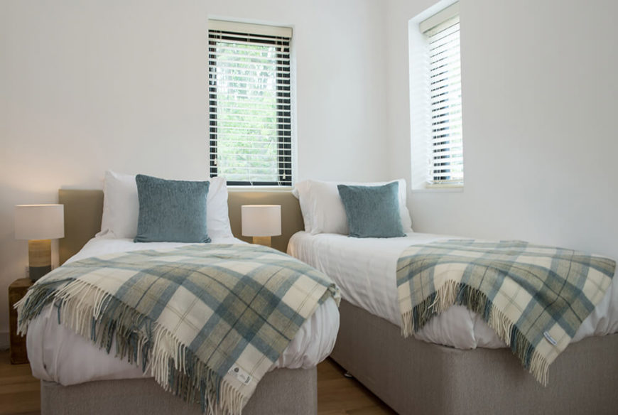 The twin bedrooms are lovely and spacious, with crisp white sheets and plaid blankets. The design is simple but stylish and wholly welcoming.