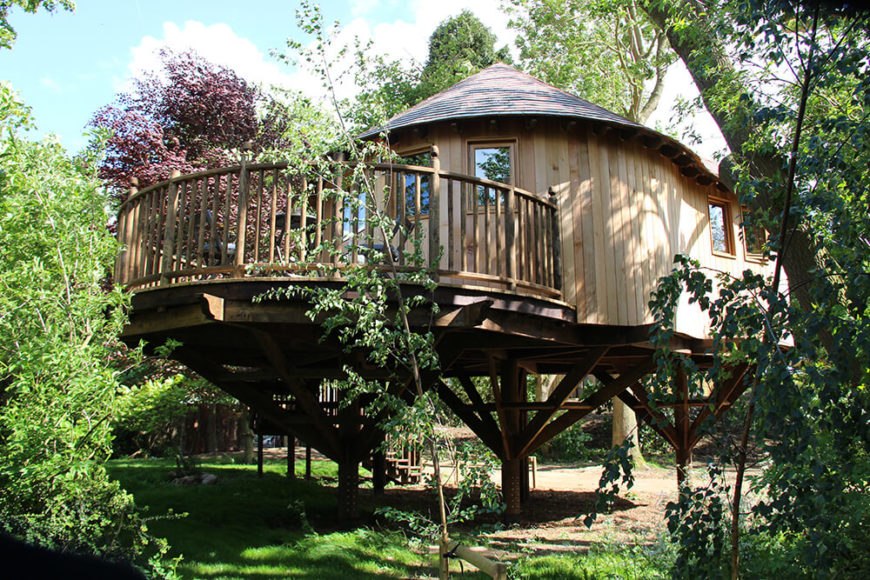 From the rear of the luxury treehouse, we can see the curved alfresco deck that is elevated above the trees to provide a fantastic countryside view.