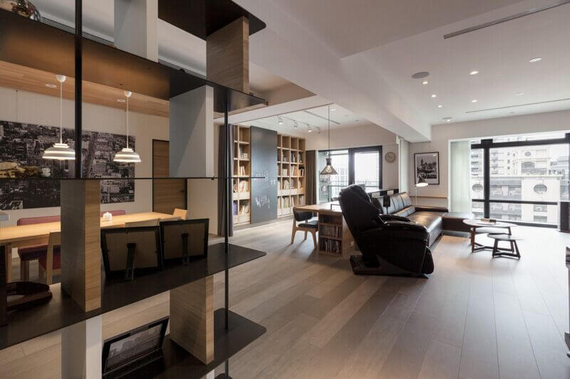 While not freestanding, these installed shelves cut into the space, and dividing this room well.