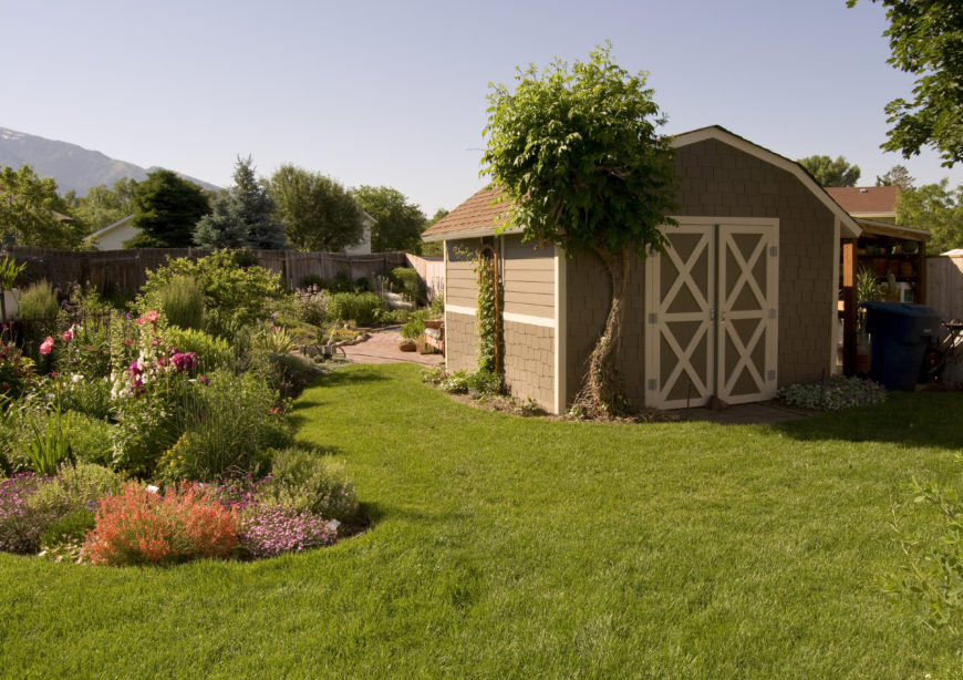Awesome backyard shed with surrounding garden.