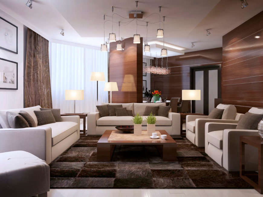 A very toned down and cozy earth tone palette is brightened up but the lighter furniture. The natural wood tones and the the sleek design are a welcoming and comfortable environment.