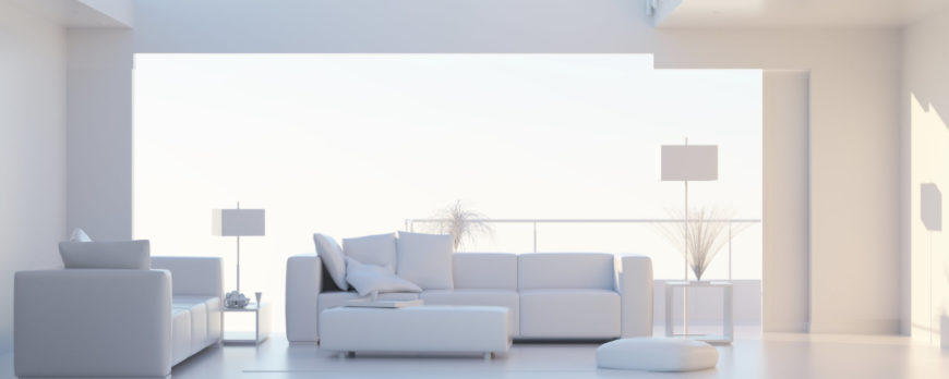 This sleek and modern all-white living room has a long and low ottoman that serves as a footstool and a table.