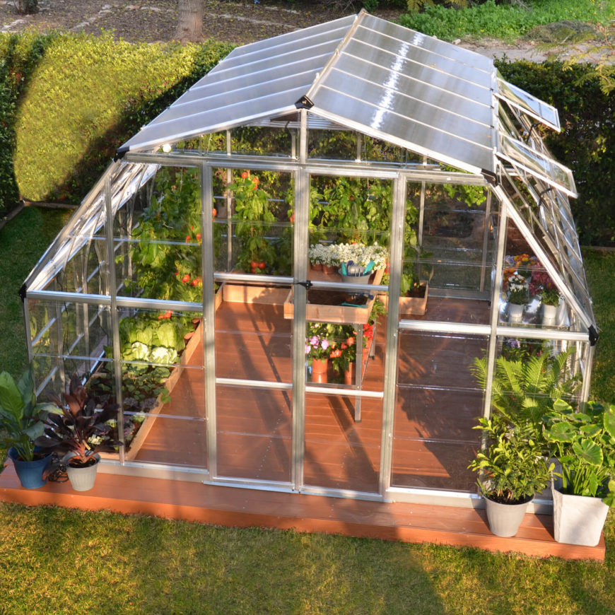 Here is a nice and spacious greenhouse from a kit. The dome design allows for hanging plants, planter plants, and a few shelves for potted plants. You can have a variety of plants in this setup.