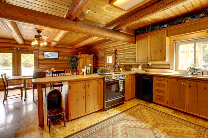 Rustic wood fills this kitchen, including the smooth pine countertops and pine cabinetry.
