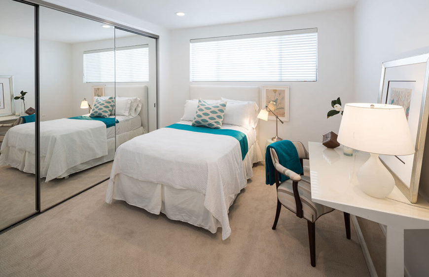 16 Bedroom - Jaxon Home - 854 18th, Santa MonicaA mirrored closet is used to reflect light around the space and make the bedroom feel much larger than it is. Sleek, light colored furniture and bedding add to this effect.
