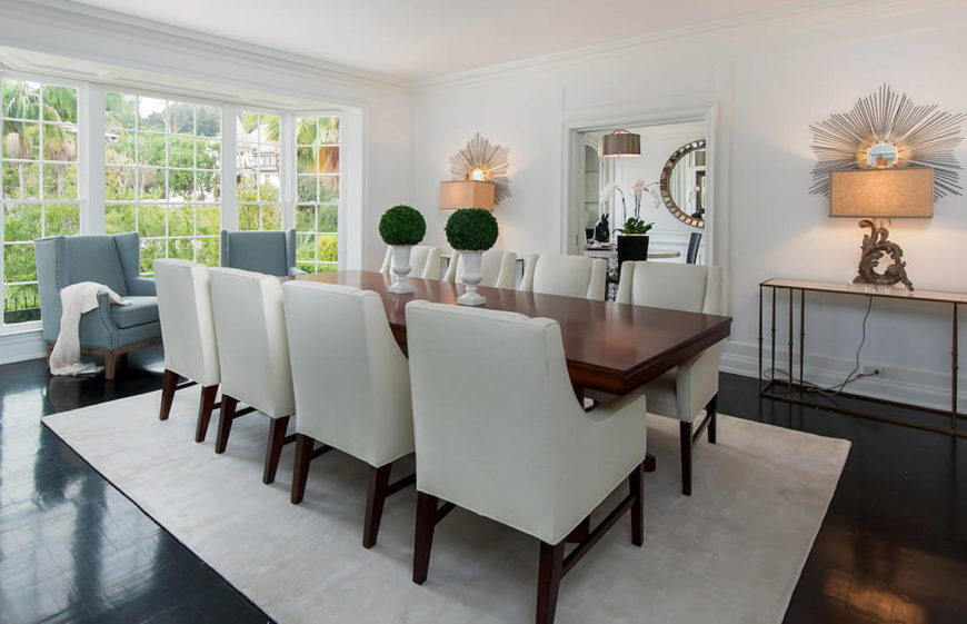 This bright and elegant dining room is spacious enough for a long dinner table and still have plenty of room to have a free, obstruction free flow through the room. The two interesting arrangements on the table help the space from looking too bare, but also are not too stuffy and distracting.