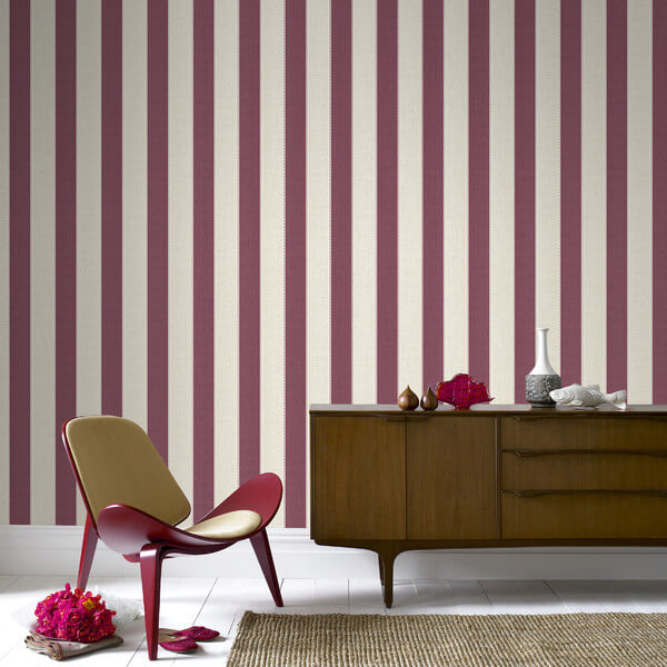 Here is a lovely wall paper used to tie the wall into the color palette of the design. Wall paper can do a lot to bring life to a design or color palette of a living room.