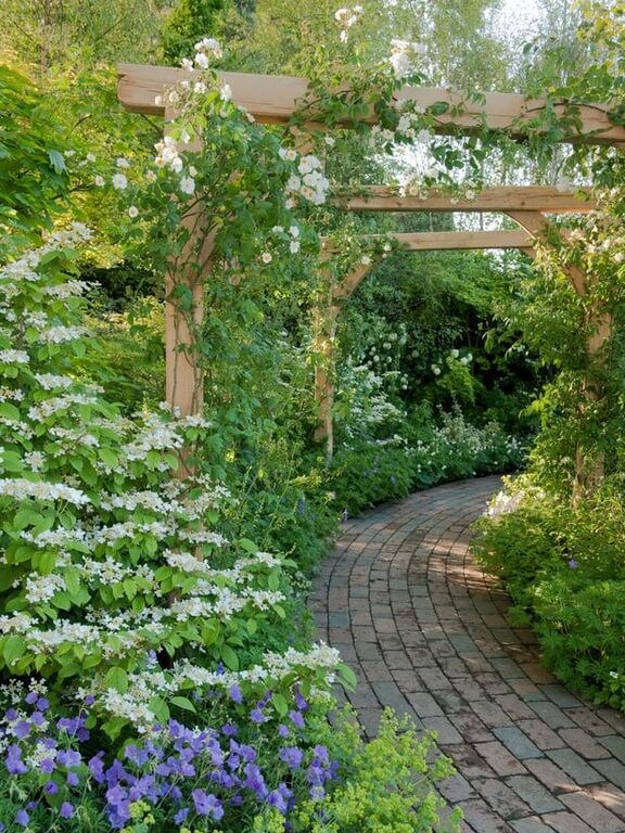Arbors don't necessarily have to be a thick portal either, as these show. Simple arbors can be made up of 2x4s, which more easily become part of the landscape. Placing multiple arbors helps create a tunnel-like effect on a garden pathway.