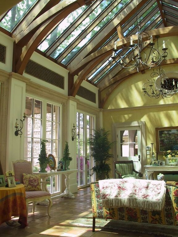 While this room does have some chandeliers, the primary source of light in the daytime comes from the skylights letting in the suns rays. Skylights are a great way to let in as much light as possible. In tandem with glass doors and windows, you can maximize your room's exposure to the sun.
