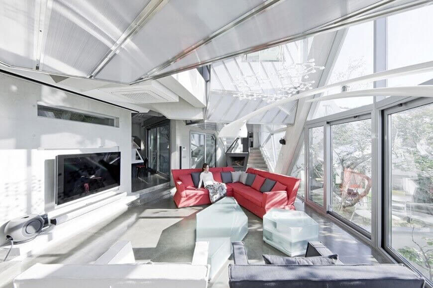 Here is an interesting ceiling with reflective glass and metal. There are also multiple levels and layers to the ceiling. This creates a visually interesting and dynamic ceiling.