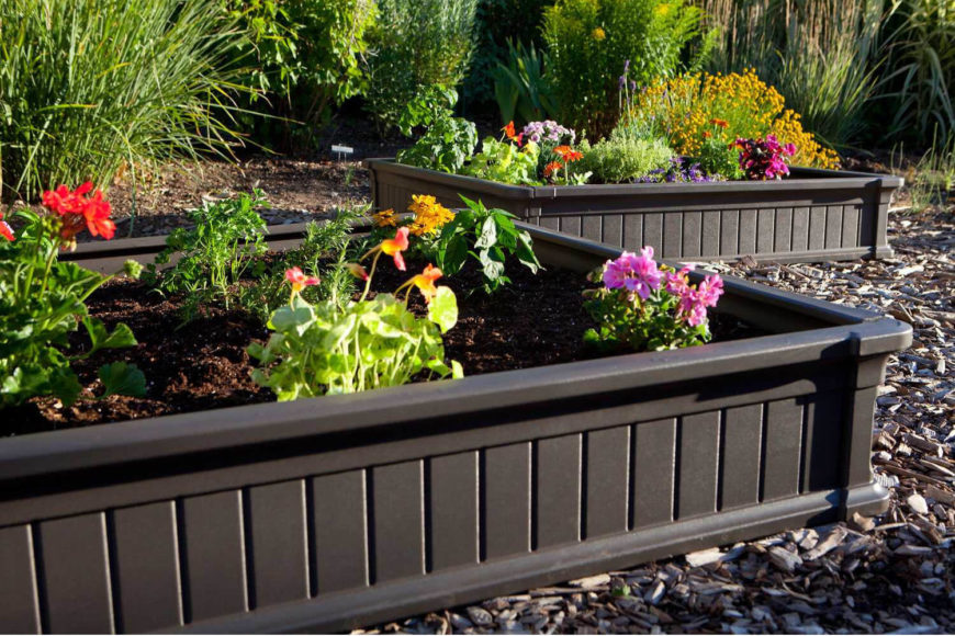 Here are a couple of small black plastic raised flower beds that are stylish and simple. These are ideal for small flowers.
