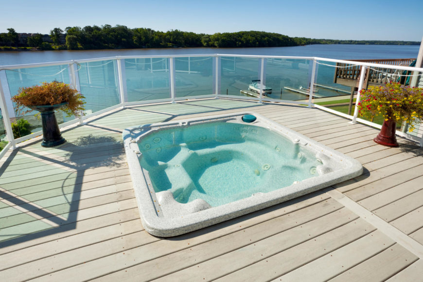Here is a hot tub overlooking the water. This is the perfect spot to let the worries fade away. If you have a view like this, there is no better place to enjoy it than in the warm soothing waters of a hot tub.