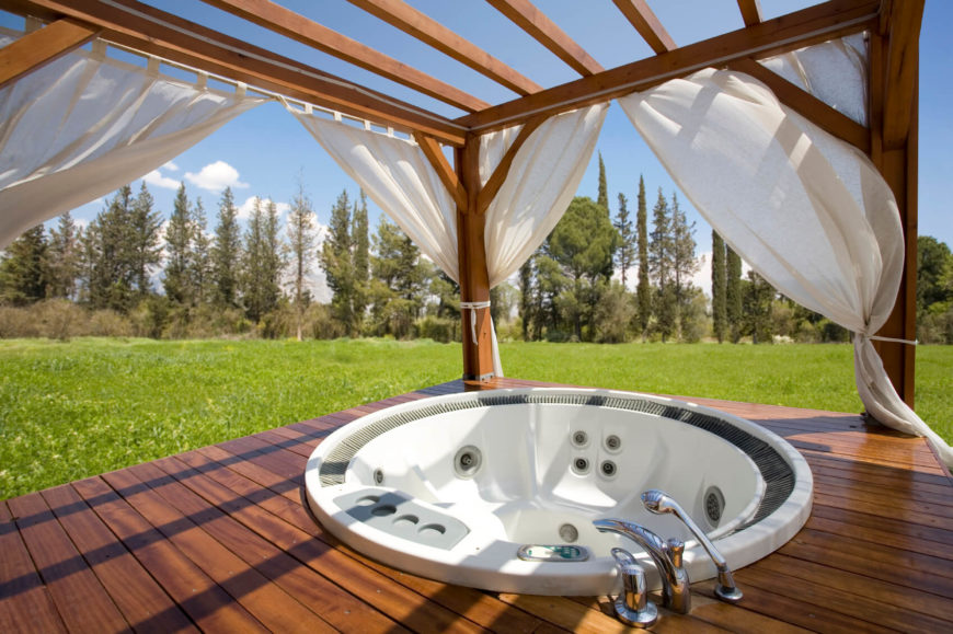 Building a structure such as this around a hot tub lets the occupants enjoy their surroundings when they want to. Closing the shades allows you to make this hot tub a private and secluded spot. The best of both worlds.