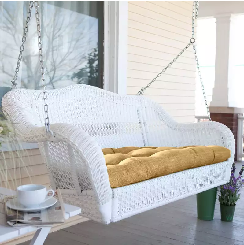 This is a classic white wicker porch swing with a comfortable padded seat. This is the kind of swing that would be ideal for starting your morning on a sunny Sunday with a cup of coffee, while you watch the sun rise.