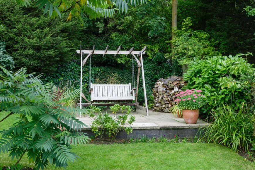 Because they are hung, swings need to be on relatively flat ground, otherwise the angle of the ground can be felt on the swing. If you don't have enough even ground, a simple patio area can can even out your ground and add a new element to your yard.