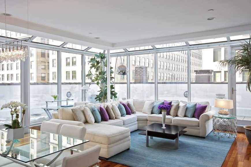 This bright and welcoming sectional sofa is the perfect sofa for this brightly lit living room. The off-white color is great for all of the natural light that is coming through the windows.