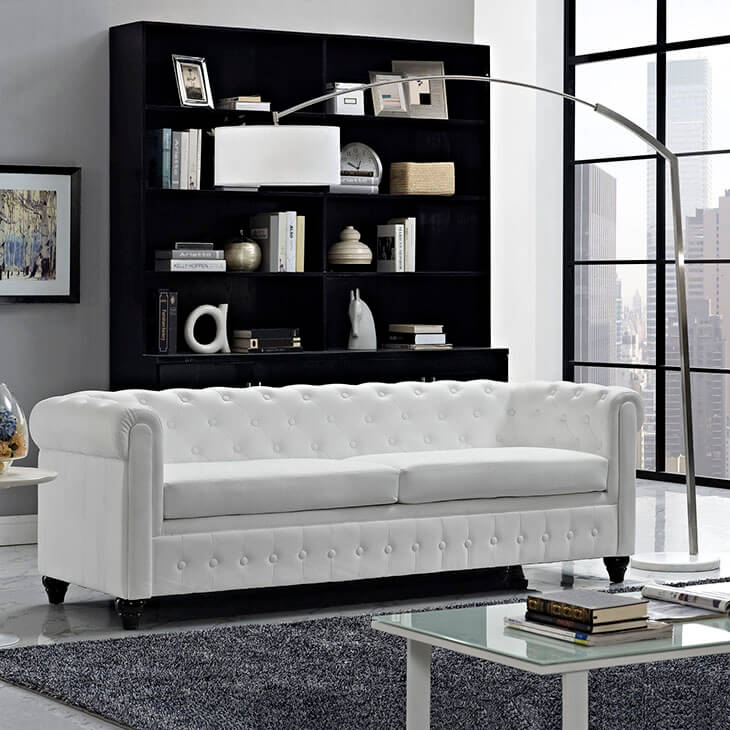 While they may require a bit of attention, stark white furniture can really make an impression. If you don't need an excessive amount of seating, a singular sofa can help aid in a minimal style, keeping the space clutter free and clean.