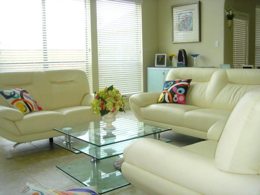 Loveseats come in many different and interesting designs. Here are a couple of matching green loveseats in this funky and modern living room. This style is perfect to make an impression without taking much space.