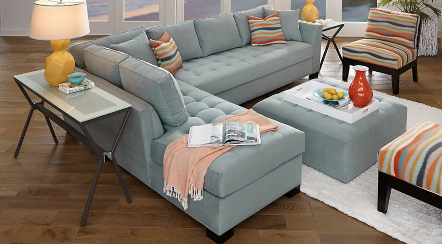Here is a classic style sectional sofa. A simple color allows the pillows to tie the sofa in with the rest of the furniture.