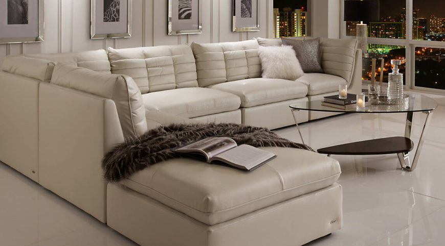 Here we see a simple white sectional sofa with a chaise lounge. Even though the design is more involved than a standard sofa, a sectional sofa can be very simple and unfussy.