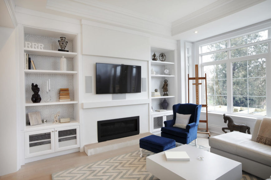 In a living room that uses a lot of white space, using a few splashes of color can bring the room to life. When your space is small, or you want a more simple design, finding places to add color can be challenging. Shelving can provide a great space to place accent items that can bring color forward.