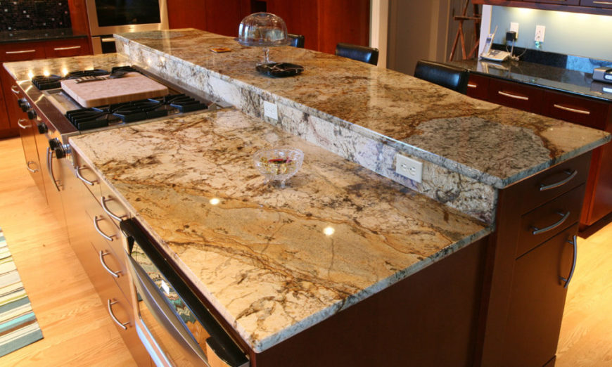 Another look at beige granite. This island is two-tiered with a small granite backsplash between the two tiers.