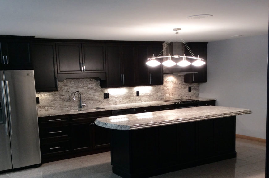 This white granite has a heavy pattern of light beige and gray veining and swirls. The color is light enough to be stunning against simple dark cabinets.