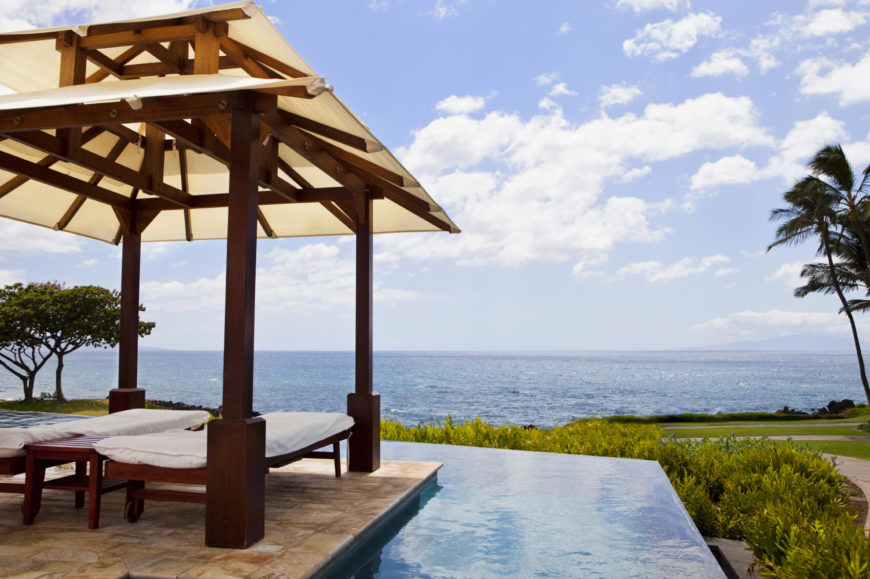 This small pavilion casts shade over two outdoor beds. It is true luxury to lay out by your pool, looking over the coast from your shady oasis. What better place for a long outdoor nap?