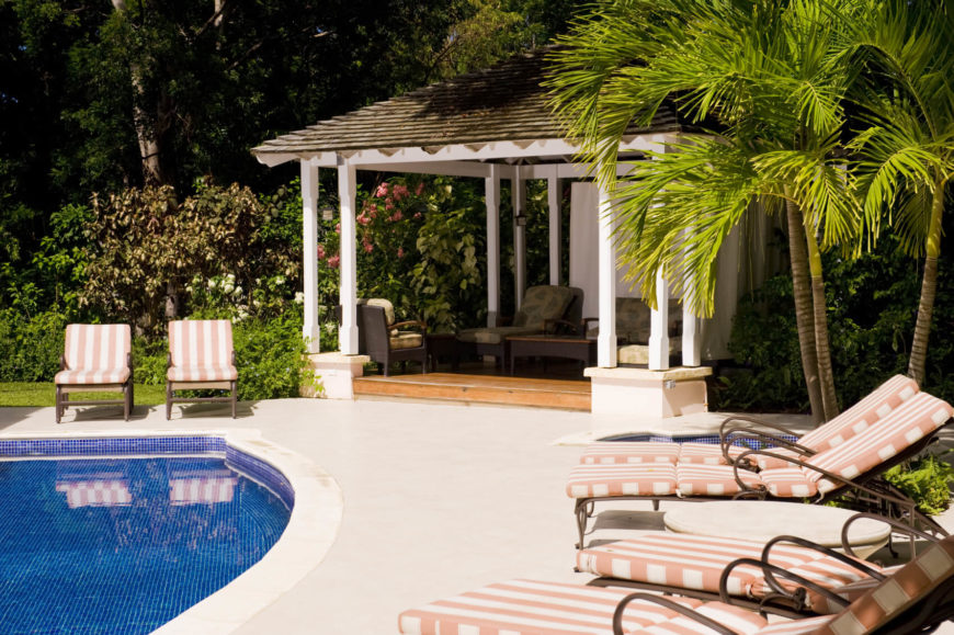 Here is a poolside pavilion that is perfect for a party. Some party goers can splash and play in the water while others kick back in the shade, tell stories, and enjoy the flowers.