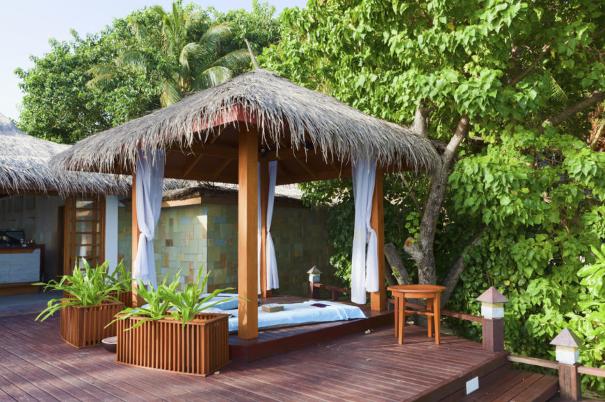 If you want to add a bit of festive texture to your pavilion, consider a thatched roof. This kind of roof gives your pavilion an island feel. You can easily escape to far off places when the islands are in your own backyard.