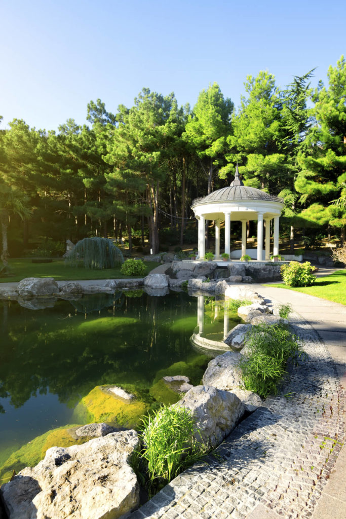 Pavilions do not necessarily need to be big. Though it works more as a design feature, this small pavilion provides a small shade respite from the sun. It punctuates the pond with a stunning structure to relax and enjoy the water.