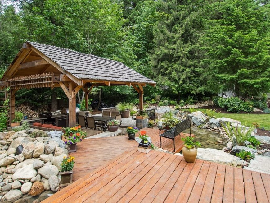 An outdoor pavilion is the best place to set up an outdoor eating area. When you have a barbeque, party or gathering, it's nice to have a protected piece of shade where people can gather together.
