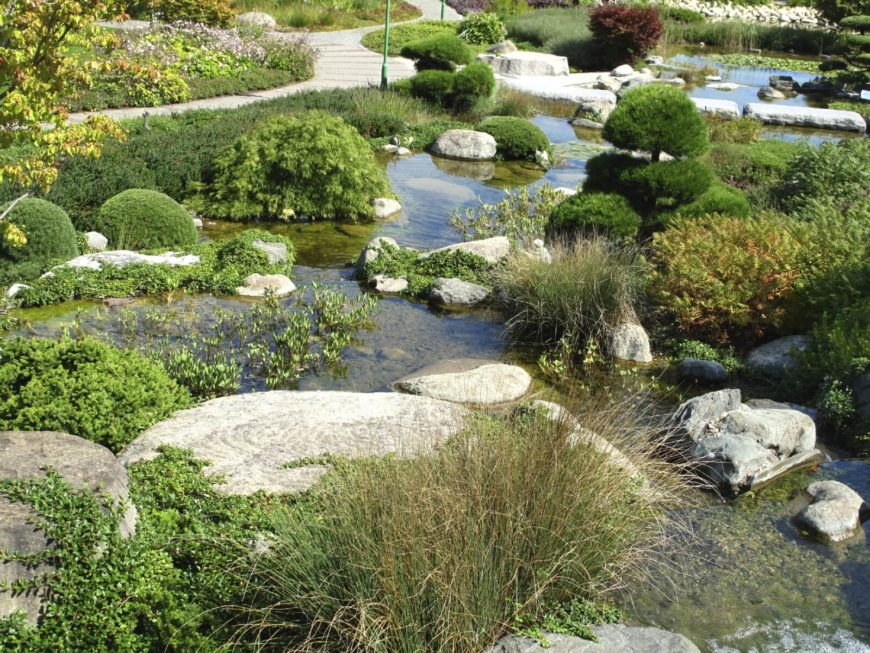 If you have a small pond or creek in your yard placing rocks in it can direct the flow. They can change the shape of your water feature into a more organic and natural feeling body of water. This works even better if you let the rocks get overtaken by greenery.