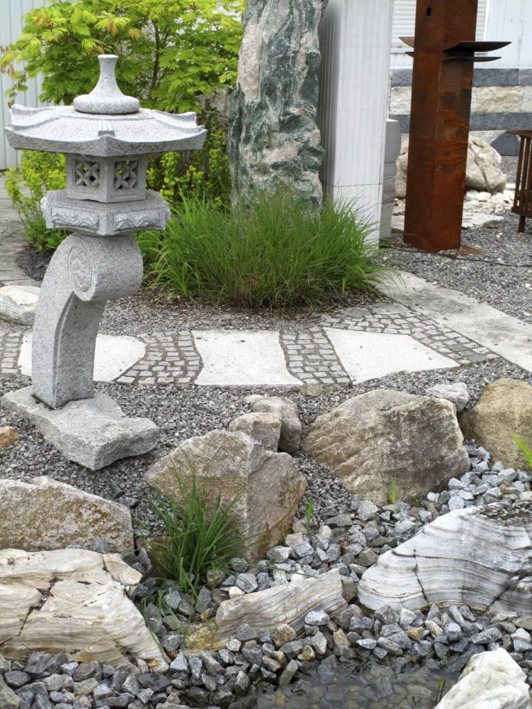 With minimal to no plants your rock garden can still bring lots of texture and visual layers to your area. A plantless rock garden is great around a path or walkway.
