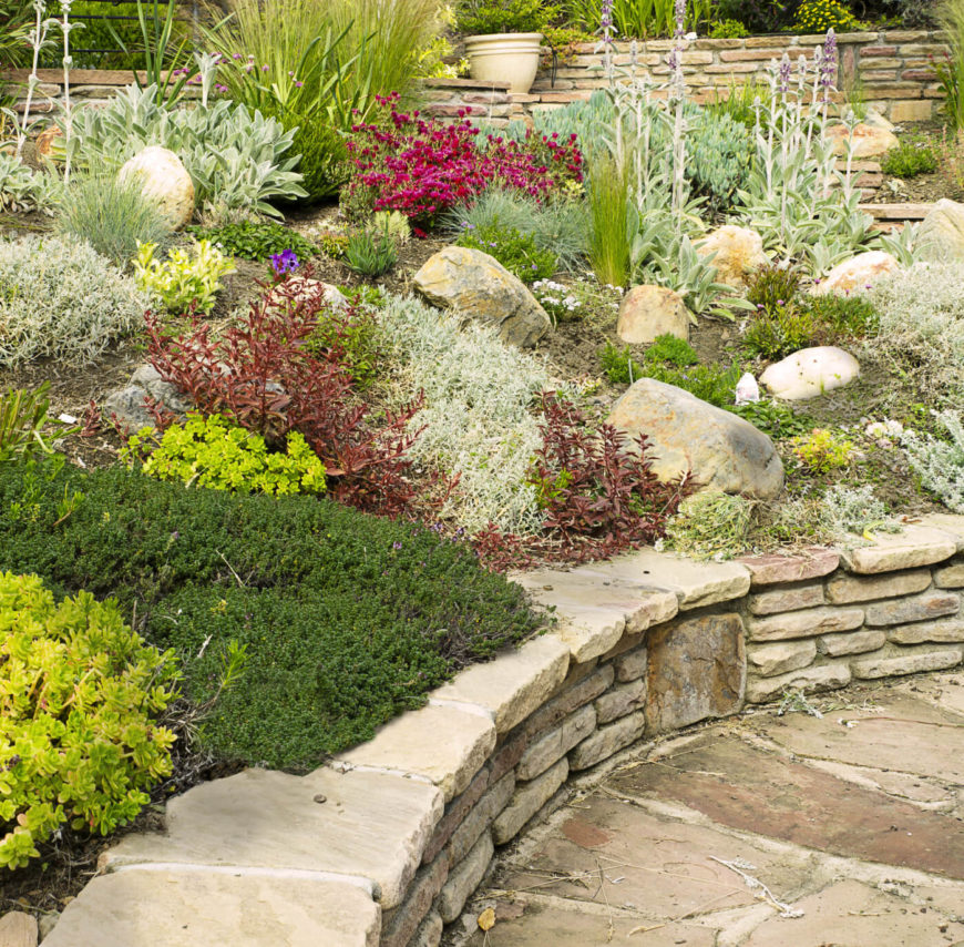 A garden does not need many rocks to attain natural texture. A few well placed stones of the right size can do the trick.
