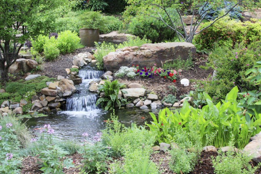 Here we see a waterfall and pond surrounded by rocks in this organic and natural looking space. One of the rocks here is very large. A very large rock like this can give your rock garden a center of focus.
