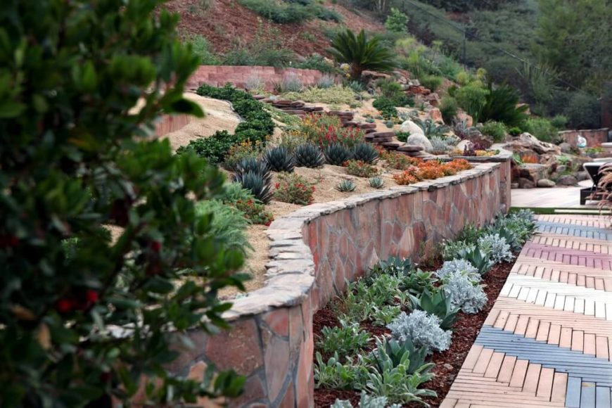 In drier areas where plant life is not as lush, adding rocks into landscaping can help build a full look. In these climates, rocks are right at home.