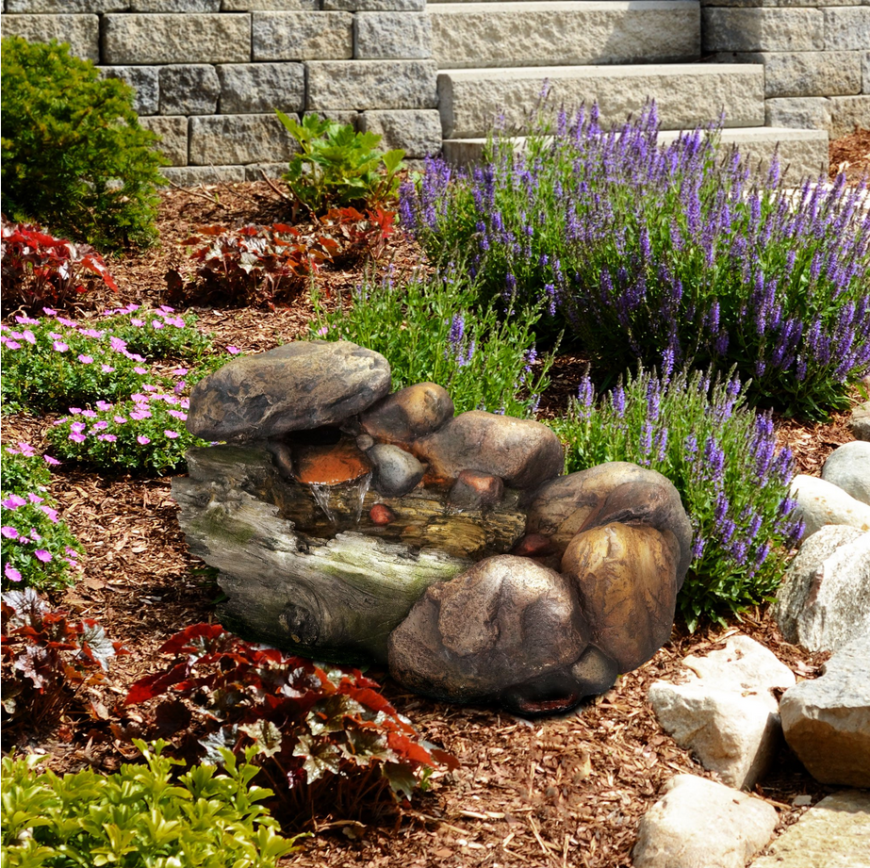 A small stone feature can make a great addition to a garden. This small stone fountain brings the appeal that rocks can add to your garden without taking up much space.