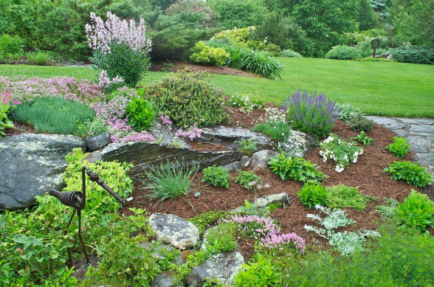 Even by adding a few stones to your garden you can introduce interesting textures to the space. This garden area has minimal stones, but these stones still have a dramatic effect on the area. They make the garden look far more naturalistic.