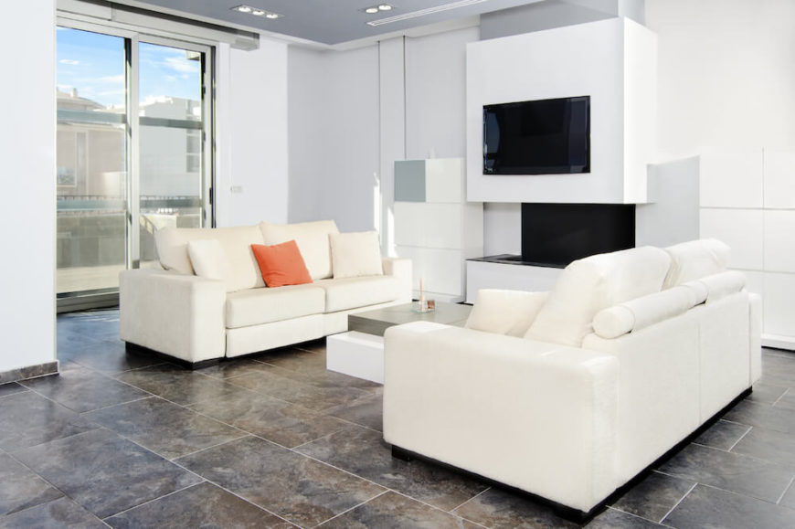 Even regular tile floors are gorgeous, particularly when paired with more modern designs. The white walls, sofas, and sharp angles of this modern living room make the warm natural tones of the tile even more impressive.