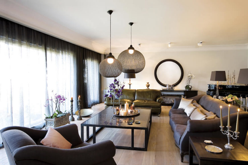 Pendant lighting above a coffee table is a great way to create a focal point in the center of a seating area.