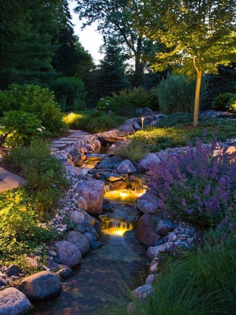 Simple stake lights and well lights can work well together to light your garden from multiple different directions, bringing out the depth of your garden.