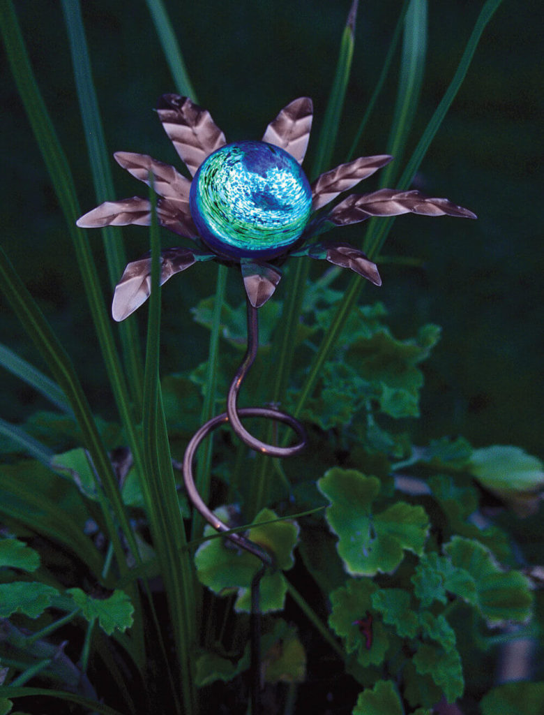 Here is an amazing piece. During the day, this piece looks like artwork - a colorful element to spice up your garden. But this piece also glows in the dark, working at night to make sure that your garden goes unscathed