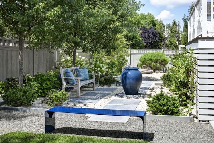 Here are two very diffrent benches in this space.One bench is a wooden and rustic bench that brings some old fashioned charm. The other is an ultra modern, super sleek and minimalistic bench. These contrasting benches still work in the same area.
