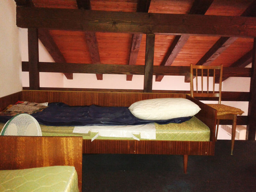 Upstairs, the bedrooms were tight. Dark beams were beautiful architectural pieces, but the tall wooden barriers detracted from them.