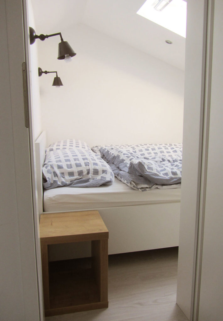 The bedroom was closed off, creating a much more private space. A skylight was added to make up for the loss of natural light.