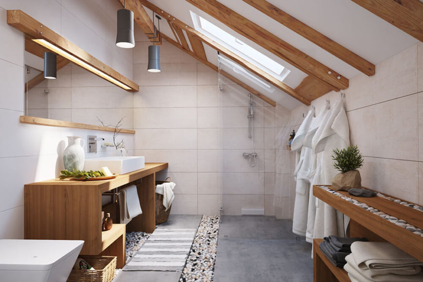 The bathroom is, understandably, the only singular room within the home. This space sports more skylights as well as a zen garden theme, with natural wood, polished stones, and an abundantly open layout.